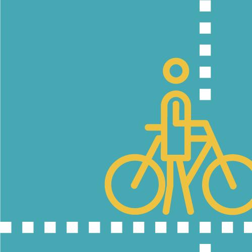 Persona caminant amb bicicleta