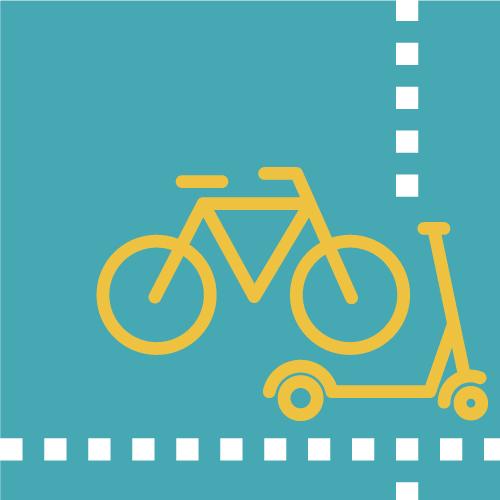 Bicicleta i patinet en carril estret