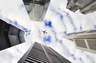 Plane flying above skyscrapers