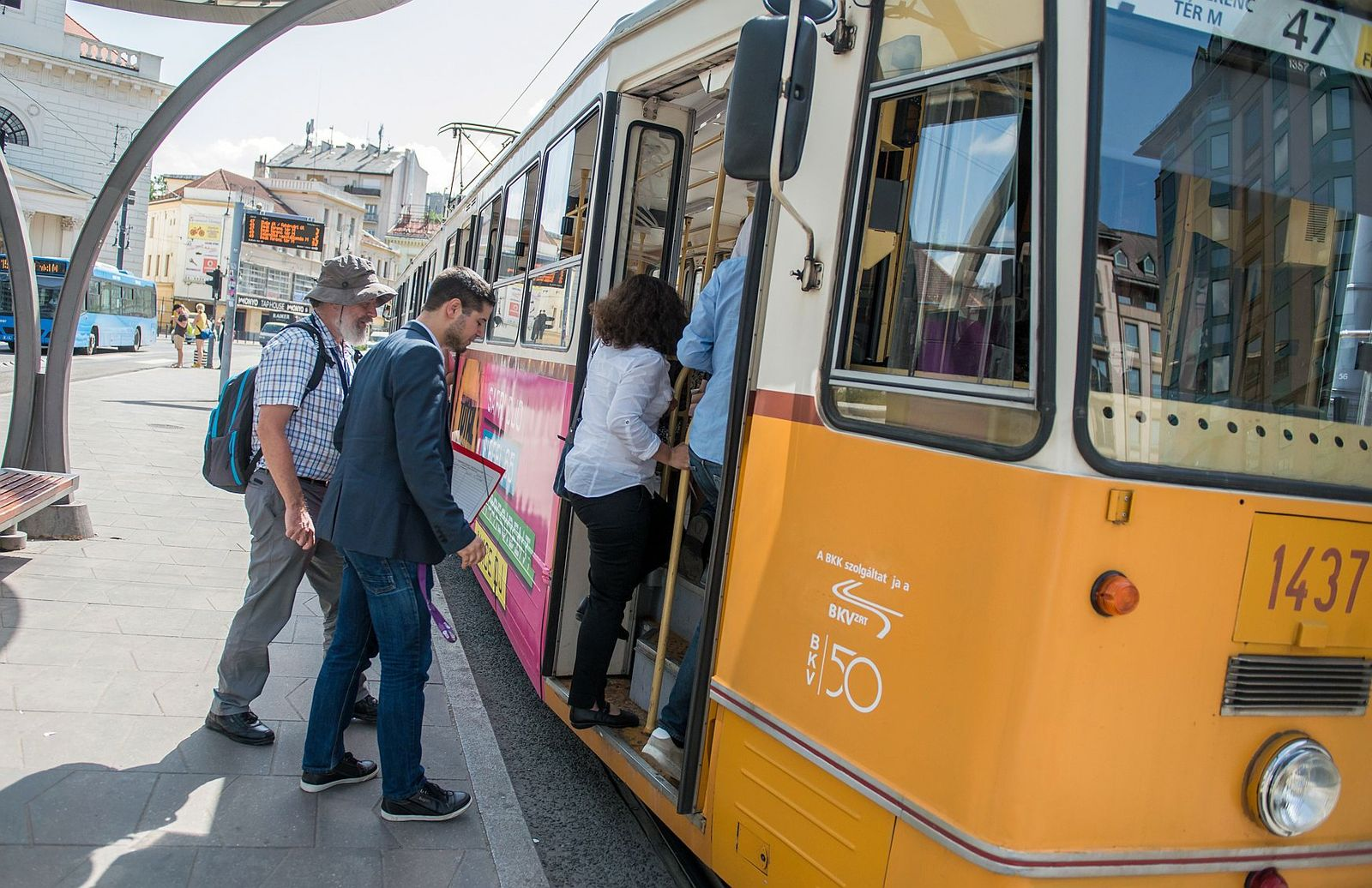 People boarding on the tram in Budapest